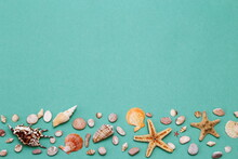 Flat Lay Travel, A Beautiful Background Of Many Small Shells And Starfish On A Textured Paper Background With A Copy Of The Space