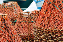Stacks Of Crab Traps In A Traditional Fishing Village In Along The Rugged Newfoundland Coast.