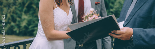 Young stylish bridal couple during the wedding ceremony which takes place on the porch of the old villa Fototapet