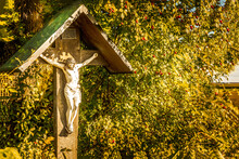 Wayside Cross With In Bavaria Next To A Tree In Autumn