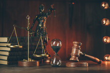 Wooden Gavel, Hourglass, Books And Lady Of Justice In Dark Room. Notary Public Tools.