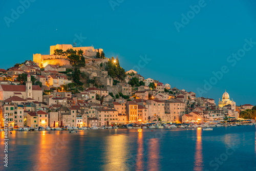 Fotografie, Tablou Sunset skyline of Sibenik with Saint James cathedral and fortress of Saint Micha