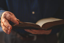 Old Bible In Hands Of An Old Man