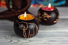 Beech Wood Candlesticks With A Picture Of An Elephant. The Candles Are Burning