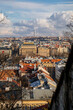Panorama aerial view of Old town cityscape from Petrin Hill, building of national theater, red roofs and Zizkov television tower in background, sunny day, Prague, Czech Republic