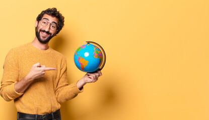 young crazy bearded man holding a world globe map.