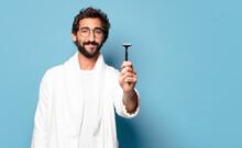 Young Crazy Bearded Man Wearing Bathrobe. Shaving Concept