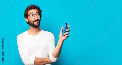 Fototapeta young bearded man smoking with a vaper obraz