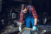 Professional Bus Mechanic Working In Vehicle Repair Service.