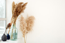 Pampas Dry Grass In Blue Vases On White Background. Boho Style Decorations. Scandinavian Minimalism Interior Decor, Copy Space For Your Text, Bohemian Stylish Trendy Concept