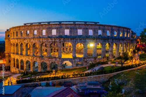 Fotografering Sunset aerial view of Roman amphitheatre in Pula, Croatia