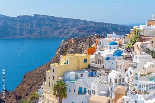 Wallpaper Mural Churches and blue cupolas of Oia town at Santorini, Greece