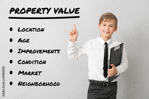 Little real estate agent with aspects of property value on light background © Pixel-Shot