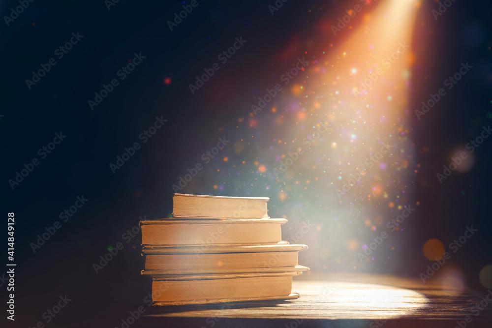 Fototapeta Magic books on dark background