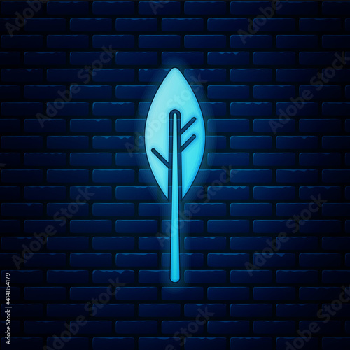 Obraz na plátně Glowing neon Indian feather icon isolated on brick wall background
