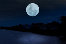 Full Moon On Sky Over River At Night.