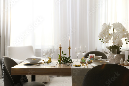 Fototapeta Beautiful Easter table setting with orchid flowers indoors obraz