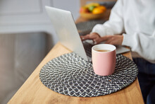 Cup With Tea Standing On A Table Mat