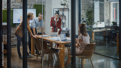 Fototapeta Diverse Group of Professional Businesspeople Meeting in the Conference Room. Stylish Busy Business Office with Creative People Working on App Design, Data Analysis, Plan Strategy for Social Media obraz