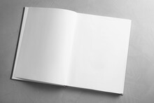 Open Book On Grey Table, Top View. Space For Text