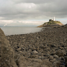 Mumbles Is A Headland Sited On The Western Edge Of Swansea Bay On The Southern Coast Of Wales