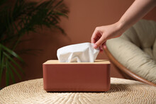 Woman Taking Paper Tissue Out Of Box On Table Indoors, Closeup