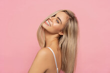 Portrait Of Happy Blonde Woman With Long Straight Hair Isolated On Pastel Background