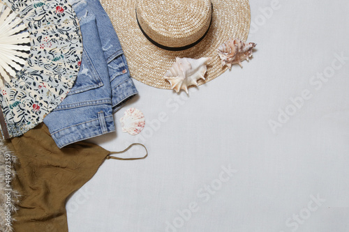 Summer outfit on white background with copy space Fototapeta