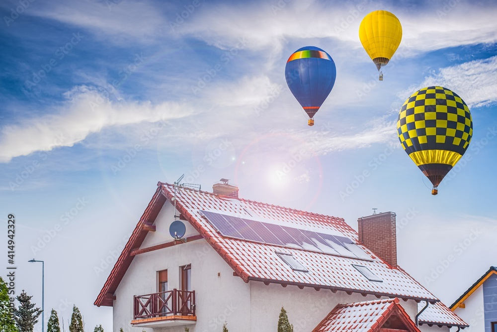 Fototapeta a balloon flies against the sky . winter landscape from a height of