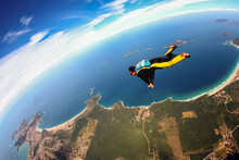 Skydiving Wing Suit Flying Over Brazilian Beach