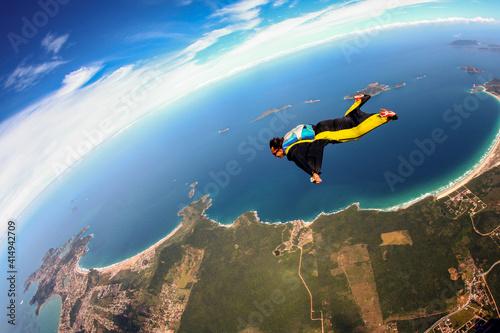 Slika na platnu Skydiving wing suit flying over Brazilian beach