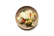 Thinly Sliced Radish Squares And Other Vegetables Including Cabbage, Scallions And Red Chili Peppers For Water Kimchi, Also Known As Nabak Kimchi On Isolated White Background.