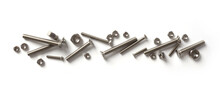 Set Of Chrome Screws And Bolts On White Background