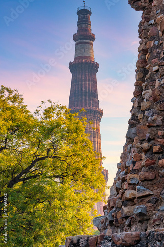 Fototapeta Qutub Minar a highest minaret in India standing 73 m tall tapering tower of five storeys made of red sandstone