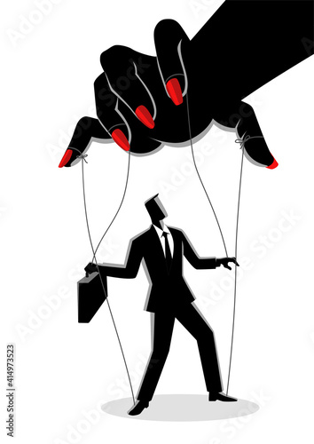 Fototapeta Businessman being control by a woman puppeteer