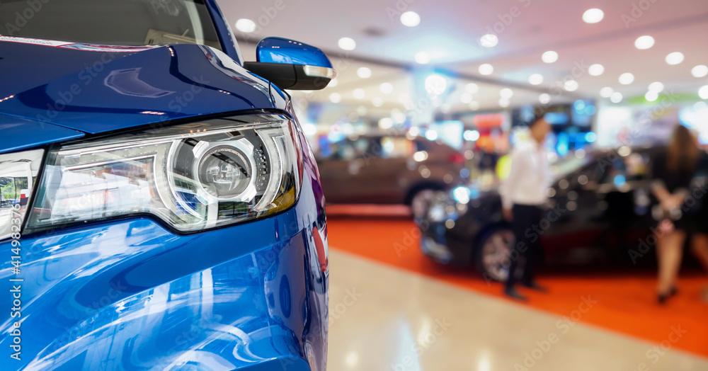 Fototapeta new cars in dealer showroom interior background