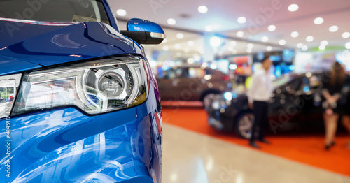 Fototapeta new cars in dealer showroom interior background obraz