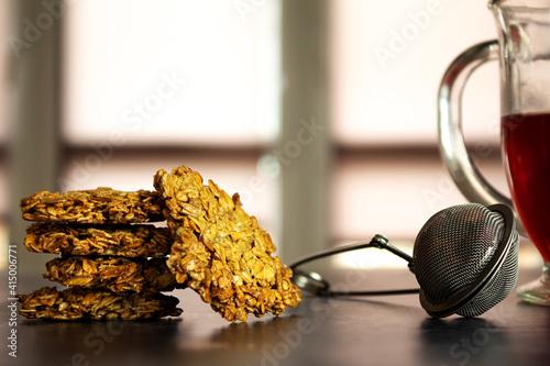 Healthy oatmeal cookies, with fruit custard tea, delicious breakfast, against th Fototapet