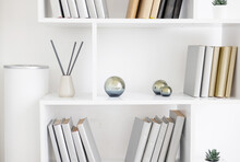White Bookshelves And Minimalist Design And Incense Sticks