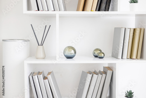 Fotografie, Obraz white bookshelves and minimalist design and incense sticks