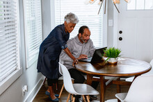 Senior Black Couple Paying Bills At Home On Laptop, Concerned And Worried