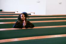 Woman Praying To God In Kingdom Church Home