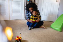 Mother And Son Playing With Remote Control Car Toy Gift For Christmas