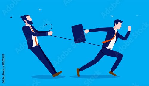 Photo Being held back - Businessman holding a man in rope preventing him from doing work