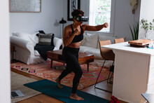 Black Woman Does Boxing Exercise At Home Using Virtual Reality Technology