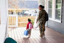 Military Woman Walks Daughter To School