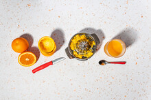 Orange Juice With Stainless Steel Juicer Kept On Modern Terrazzo Marble