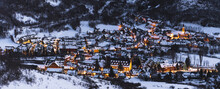 Spain, Cataluna, Baqueira, Ski Resort Covered With Snow Illuminated At Dusk