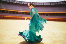 Young Woman Wearing Blue Dress Flamenco Dancing In Bullring