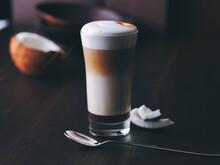 Glass Of Latte Macchiato Flavored With Coconut